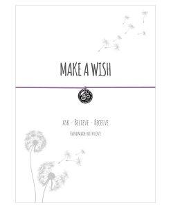 Armband Make a wish in der Farbe flieder mit einem Om Zeichen als Anhänger in silber