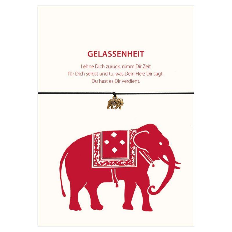 Armband Gelassenheit vom Schloss Elmau in der Farbe schwarz mit einem Elefant in rot und Anhänger in gold