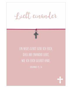 Armband Liebt einander in den Farben schwarz und pink mit einem Kreuz Anhänger in silber